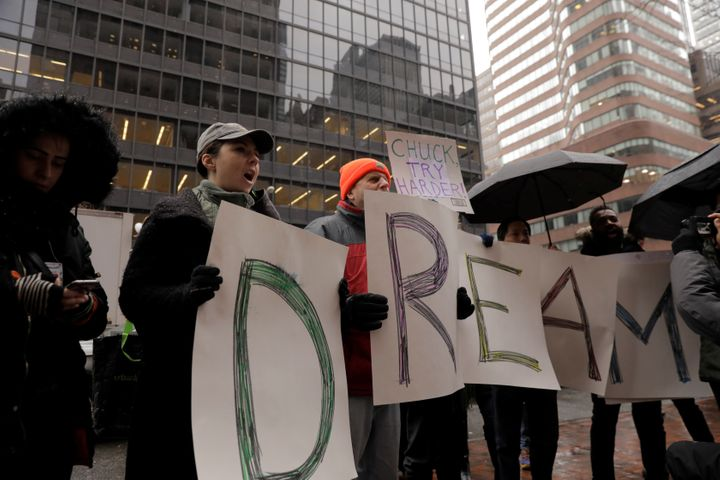 Activists outside the New York office of Sen. Chuck Schumer (D-N.Y.) on Wednesday ask that protections under the Deferred Act