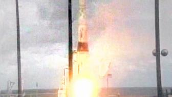 CAPTION CORRECTION/CLARIFICATION The Ballistic Missile Defense Organization (BMDO) announced July 15, 2001 it has successfully completed a test involving a planned intercept of an intercontinental ballistic missile target. The test took place over the central Pacific Ocean. A modified Minuteman intercontinental ballistic missile (ICBM) (shown here) was launched from Vandenberg AFB, California and a prototype interceptor was launched approximately 20 minutes later 4,800 miles away from the Ronald Reagan Missile Site Kwajalein Atoll in the Republic of the Marshall Islands. The intercept took place approximately 10 minutes after the interceptor was launched, at an altitude in excess of 140 miles above the earth, and during the midcourse phase of the target warhead's flight.  HK