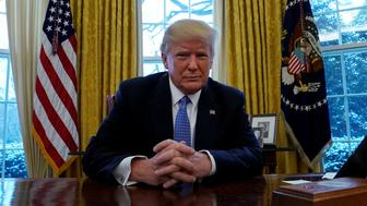 U.S. President Donald Trump sits at the Resolute Desk  during an interview with Reuters at the White House in Washington, U.S., January 17, 2018. REUTERS/Kevin Lamarque