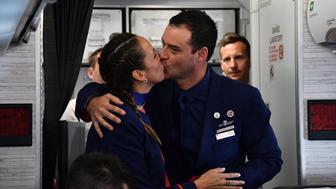 Crew members Paula Podest and Carlos Ciufffardi kiss after being married by Pope Francis during the flight between Santiago and the northern city of Iquique on January 18, 2018. Pope Francis married the couple during the flight to Iquique where he will celebrate an open-air mass on the beach before leaving for Peru on the last leg of his South American trip. / AFP PHOTO / POOL / Vincenzo PINTO        (Photo credit should read VINCENZO PINTO/AFP/Getty Images)
