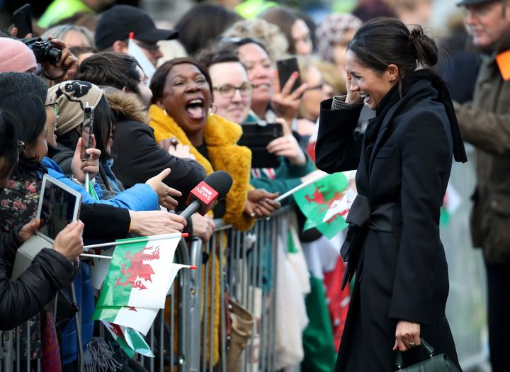 Meghan Markle chats with fans during her visit to Cardiff Castle.