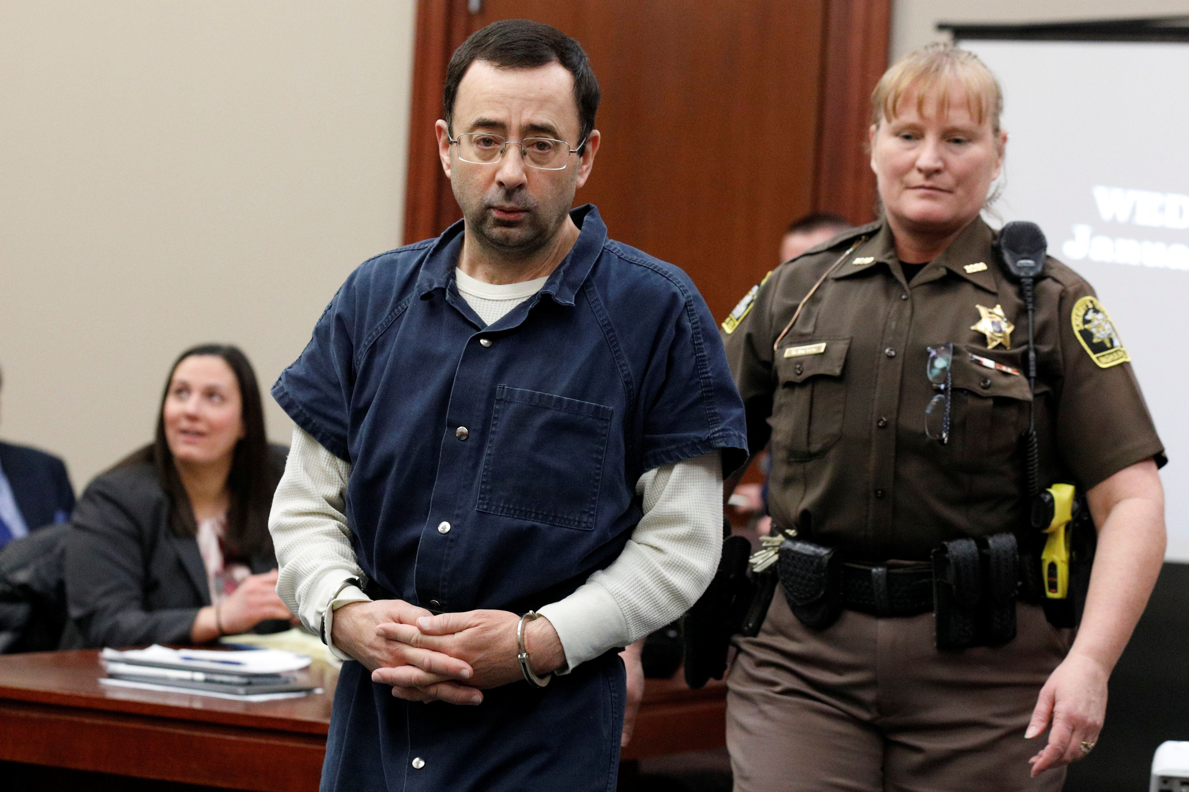 Larry Nassar is escorted by a court officer during his sentencing hearing in Lansing, Michigan, on Jan. 17, 2018.