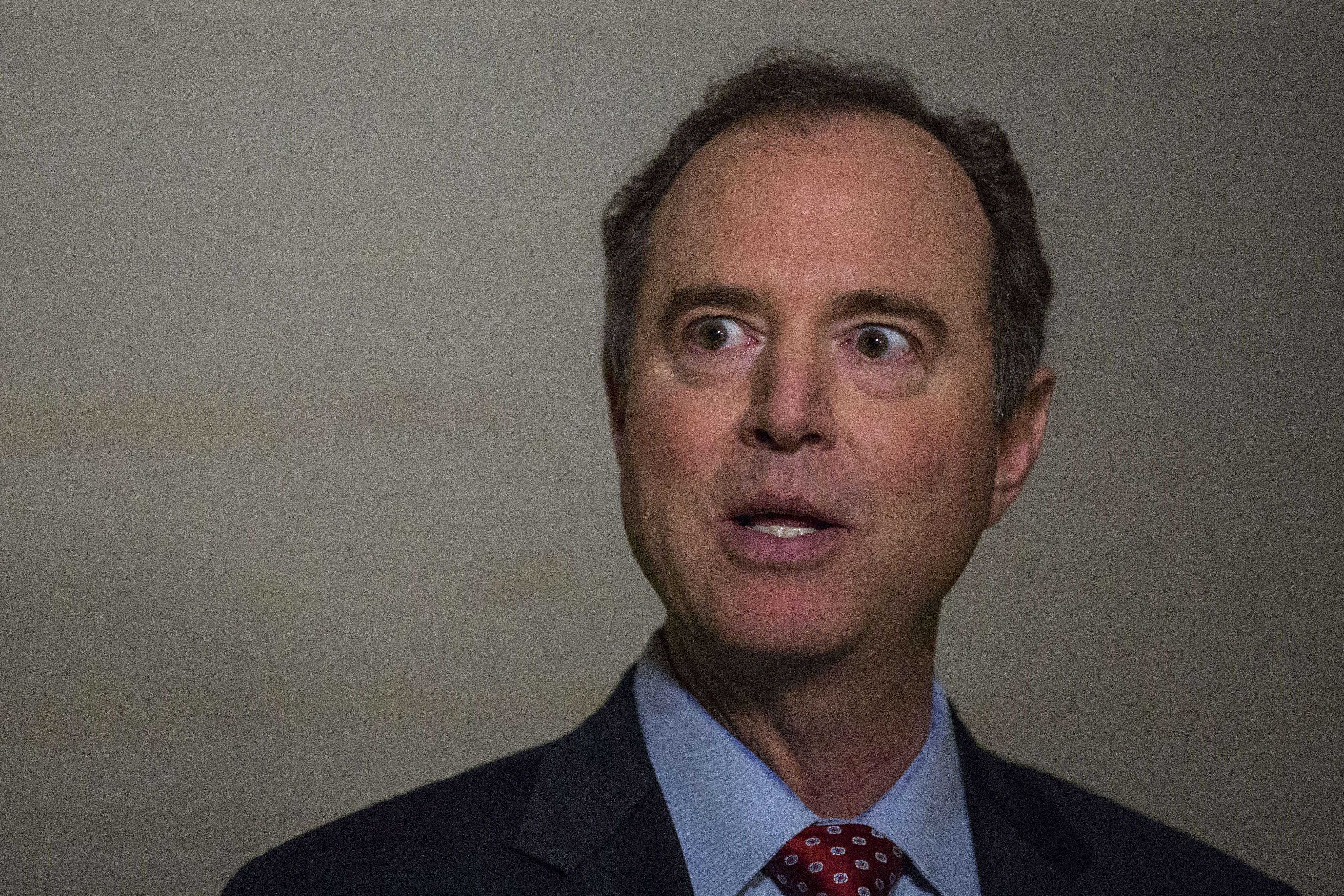 Representative Adam Schiff, a Democrat from California and ranking member of the House Intelligence Committee, speaks with members of the media following testimony by Steve Bannon, former chairman of Breitbart News Network LLC, not pictured, on Capitol Hill in Washington, D.C., U.S., on Tuesday, Jan. 16, 2018. The House Intelligence Committee issued a subpoena Tuesday for testimony by Bannon after his closed-door interview with the panel's Russia probe became entangled in legal disputes over whether the former chief strategist to President Donald Trump could invoke executive privilege. Photographer: Zach Gibson/Bloomberg via Getty Images
