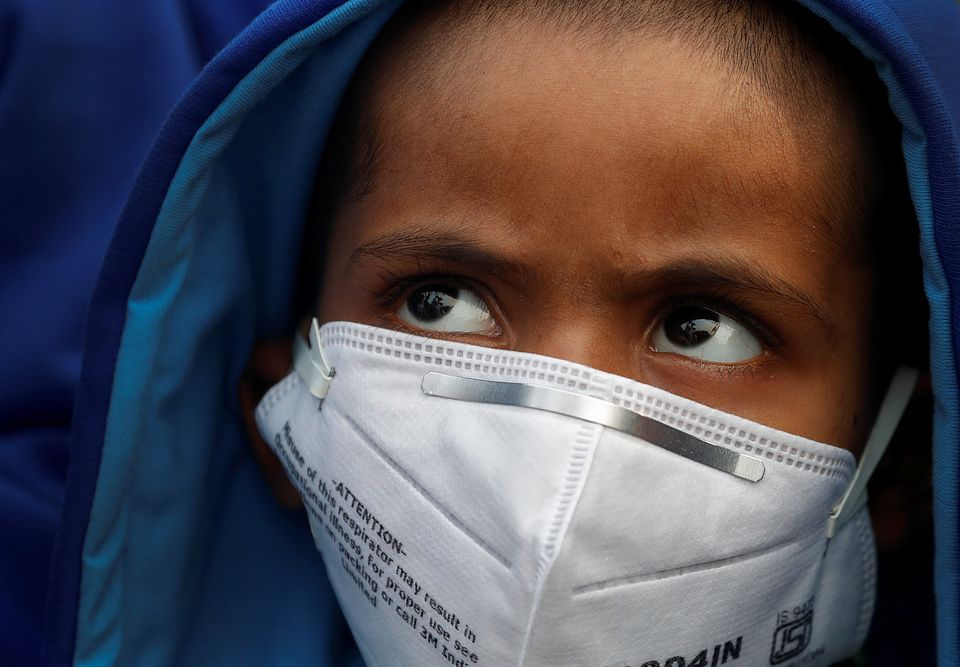 A child wearing a face mask in Delhi.