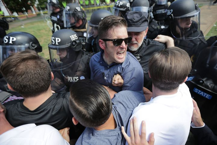Spencer (in glasses) jammed against a line of riot cops during a white supremacist rally in Charlottesville, Virginia, on Aug