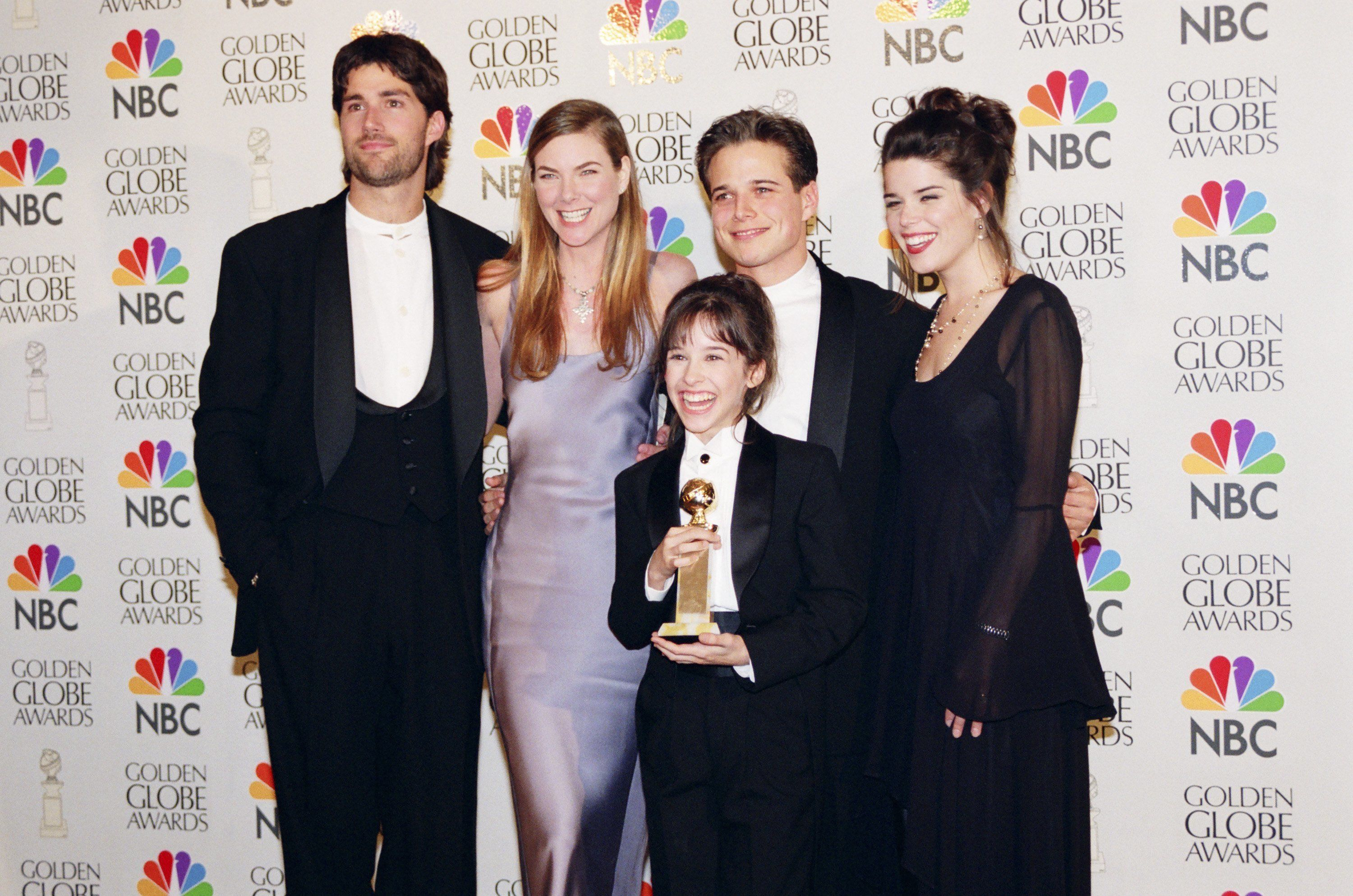 53RD ANNUAL GOLDEN GLOBE AWARDS -- Pictured: (l-r) Golden Globe winners for best Television Series - Drama the cast of Party of Five in the photo room during the 53rd Annual Golden Globe Awards held at the Beverly Hilton Hotel on January 21, 1996-- Photo by: Joseph Del Valle/NBCU Photo Bank
