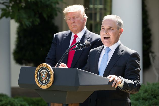 Pruitt and President Donald Trump in June 2016 as they announce plans to withdraw from the Paris...