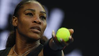 Serena Williams of the US serves against Venus Williams of the US during the women's singles final on day 13 of the Australian Open tennis tournament in Melbourne on January 28, 2017. / AFP / PAUL CROCK / IMAGE RESTRICTED TO EDITORIAL USE - STRICTLY NO COMMERCIAL USE        (Photo credit should read PAUL CROCK/AFP/Getty Images)