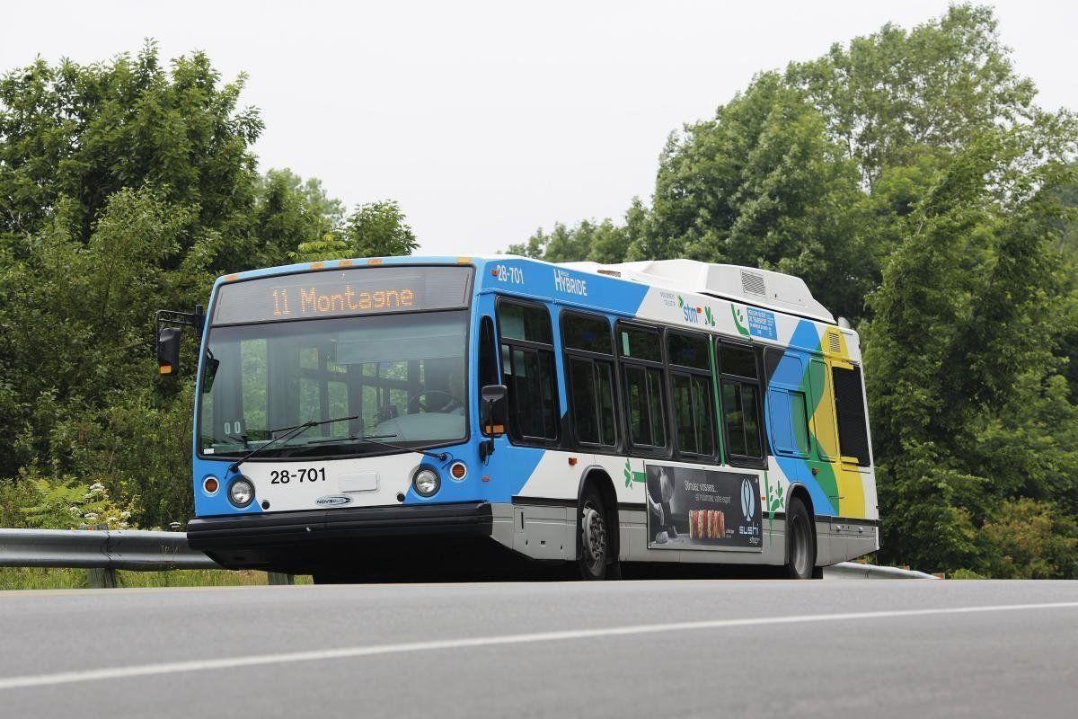 Société de transport de Montréal is hoping to expand its network of hybrid buses, such as those above, a