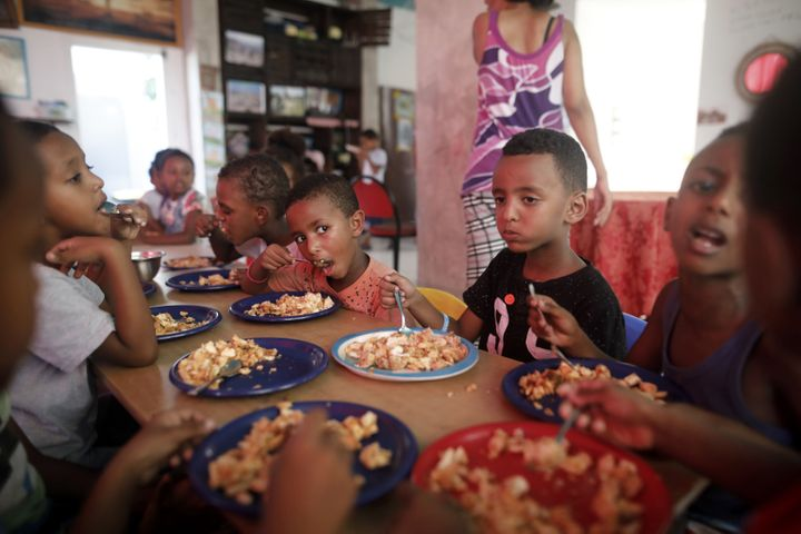 The children of African Eritrean migrants eat lunch at a makeshift kindergarten in southern Tel Aviv in September 2017.