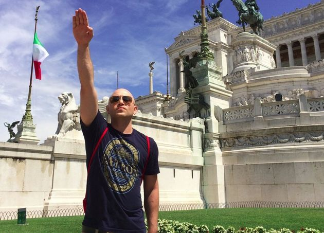 Andrew Anglin gives the Nazi salute in