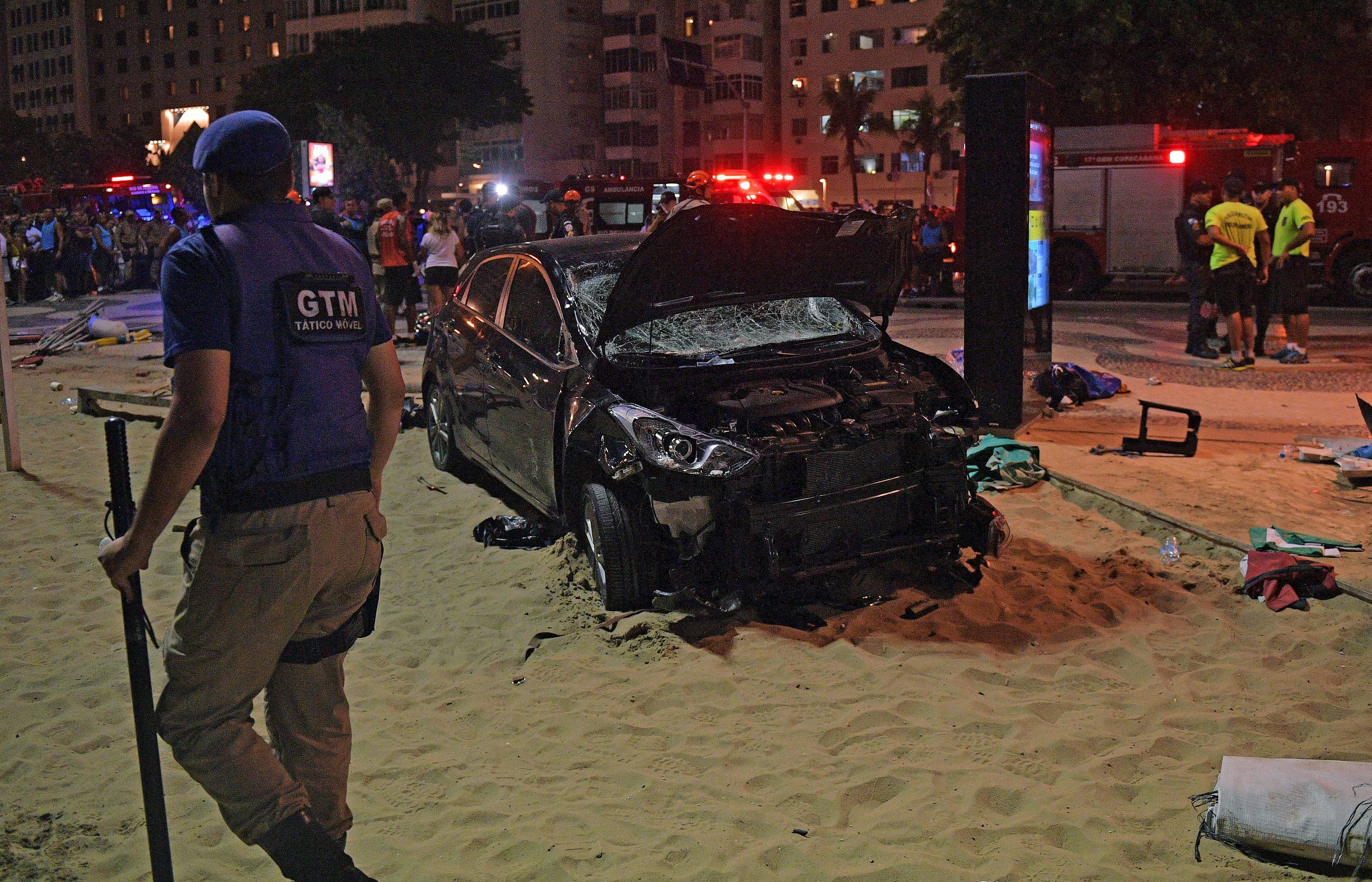 The scene of a car crash pictured at Copacabana beach in Rio de Janeiro on January 18, 2018. At least 11 people were injured by a car that drove up onto Copacabana's tourist-packed seafront promenade in the heart of Rio de Janeiro. / AFP PHOTO / CARL DE SOUZA        (Photo credit should read CARL DE SOUZA/AFP/Getty Images)