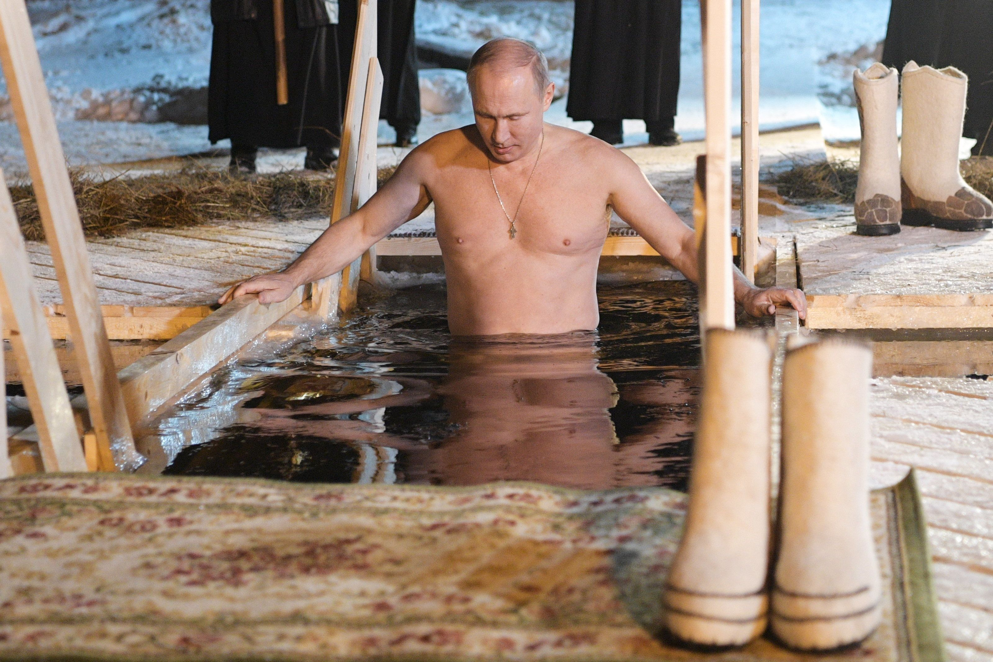 Vladimir Putin Strips For Ice-Cold Dip During Religious