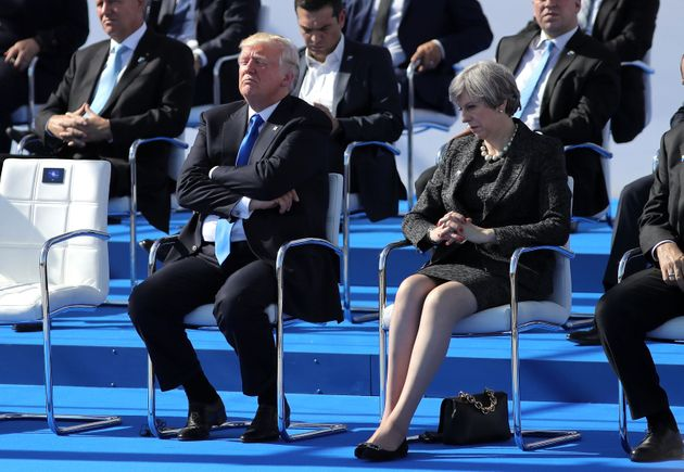 Four months after the hand holding, May and Trump met at the Nato summit in Brussels and looked less...