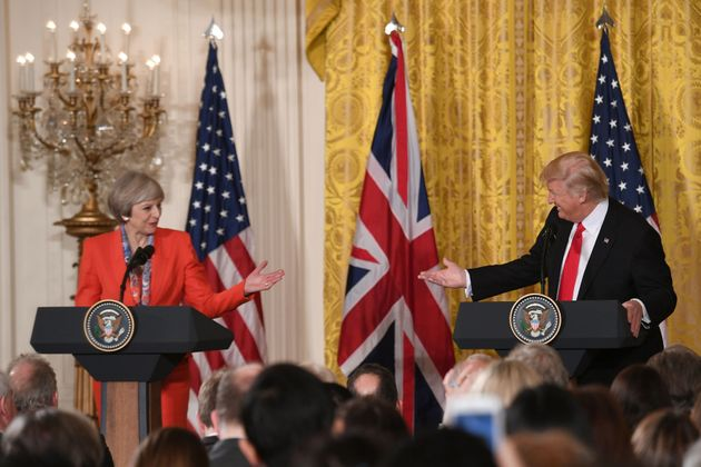 All smiles: Trump and May at their January meeting. He signed the travel ban order just after she left...