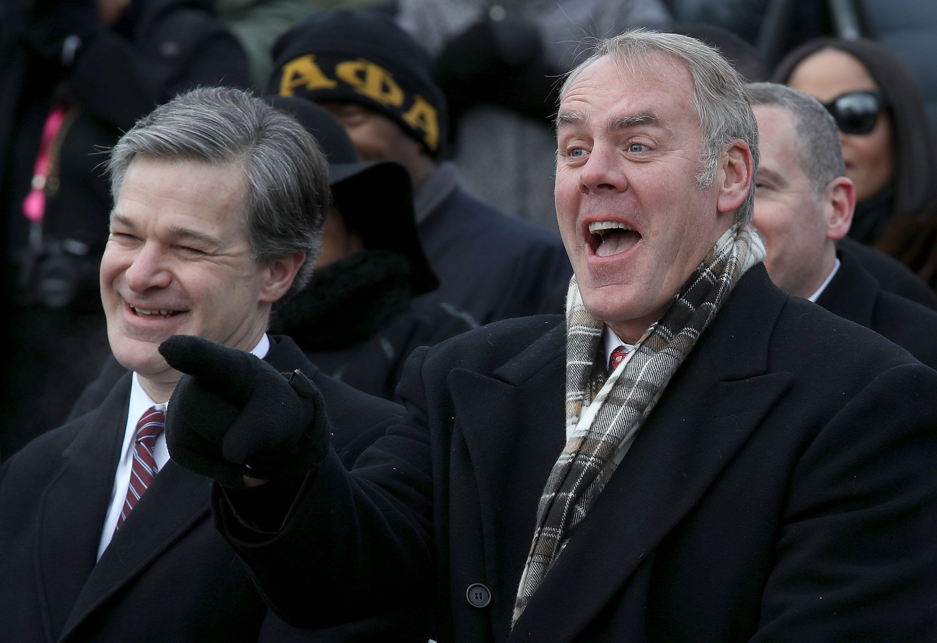 WASHINGTON, DC - JANUARY 15:  Interior Secretary Ryan Zinke (R) and FBI Director Christopher Wray (L) take part in a ceremony at the Martin Luther King Jr. Memorial on Martin Luther King Day January 15, 2018 in Washington DC. Martin Luther King Jr. would have been 89 years old today. The two were laughing about a joke made by one of the speakers during the ceremony. (Photo by Win McNamee/Getty Images)