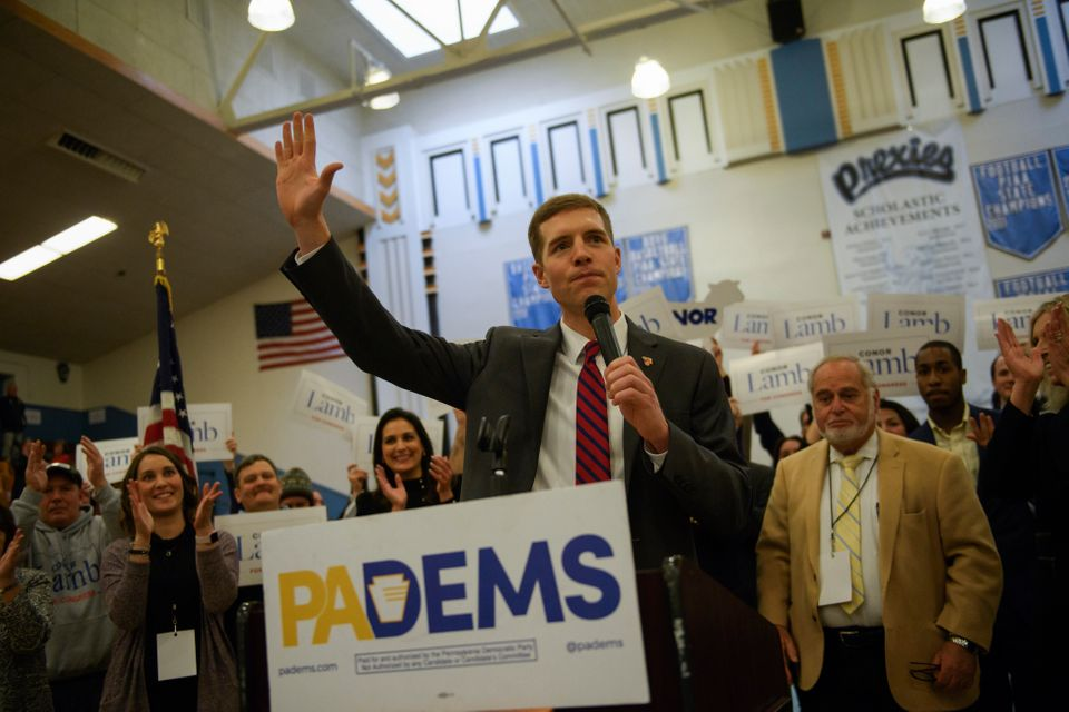 Conor Lamb reacts to winning the Democratic nomination for the 18th Districtseat inside Washington High School gymnasiu