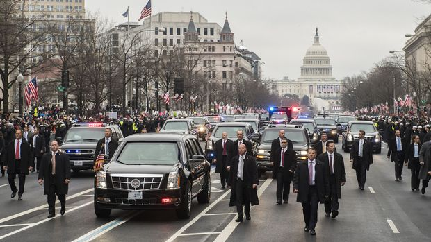 FILE: Members of the secret service walk next to the limousine carrying U.S. President Donald Trump and First Lady Melania Trump drives in the 58th presidential inauguration parade in Washington, D.C., U.S., on Friday, Jan. 20, 2017. The one year anniversary of U.S. President Donald Trump's inauguration falls on Saturday, January 20, 2018. Our editors select the best archive images looking back over Trumps first year in office. Photographer: Kevin Dietsch/Pool via Bloomberg