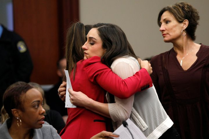 Aly Raisman, left, embraces Jordyn Wieber during the sentencing hearing for Larry Nassar.