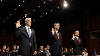 (L-R) Colin Stretch, general counsel for Facebook, Sean Edgett, acting general counsel for Twitter, and Richard Salgado, director of law enforcement and information security at Google, are sworn in prior to testifying before the Senate Intelligence Committee to answer questions related to Russian use of social media to influence U.S. elections, on Capitol Hill in Washington, U.S., November 1, 2017.   REUTERS/Joshua Roberts