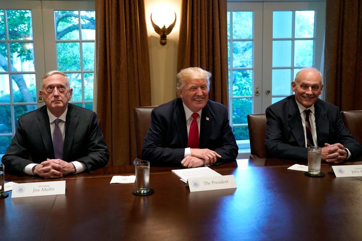 President Donald Trump, flanked at a White House meeting on Oct. 5, 2017, by Defense Secretary James Mattis and White House C