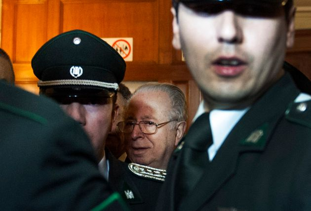 Chilean priest Fernando Karadima leaves a courtroom in Santiago, Chile, on Nov. 11,