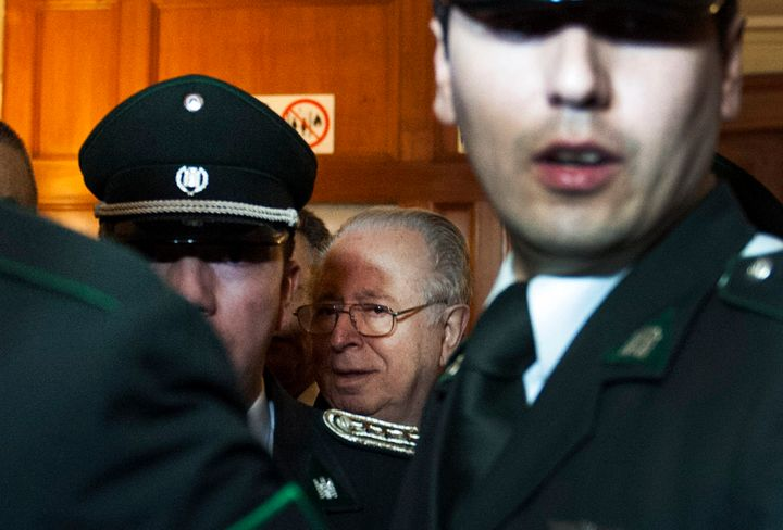 Chilean priest Fernando Karadima leaves a courtroom in Santiago, Chile, on Nov. 11, 2015.