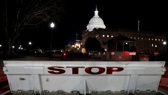 U.S. Capitol is seen shortly after beginning of the Government shutdown in Washington, U.S., January 20, 2018. REUTERS/Yuri Gripas
