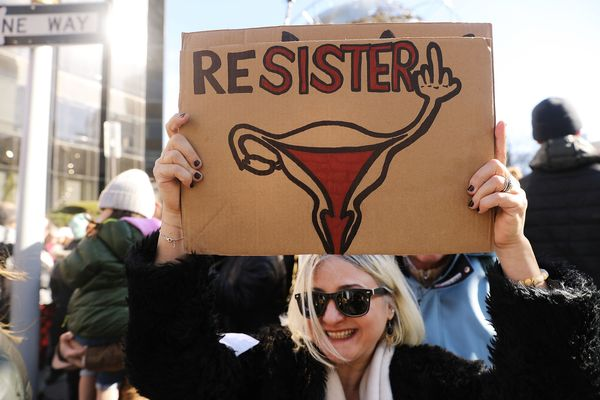 Woman holds sign at Women's March in New York City.