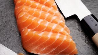 Fresh Salmon Sashimi with Sashimi Knife.