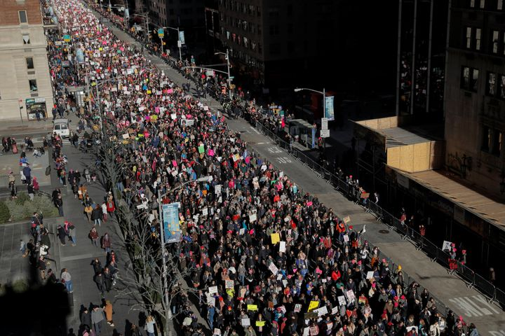 People walk down Sixth Avenue as part of the Women's March in Manhattan on Saturday.