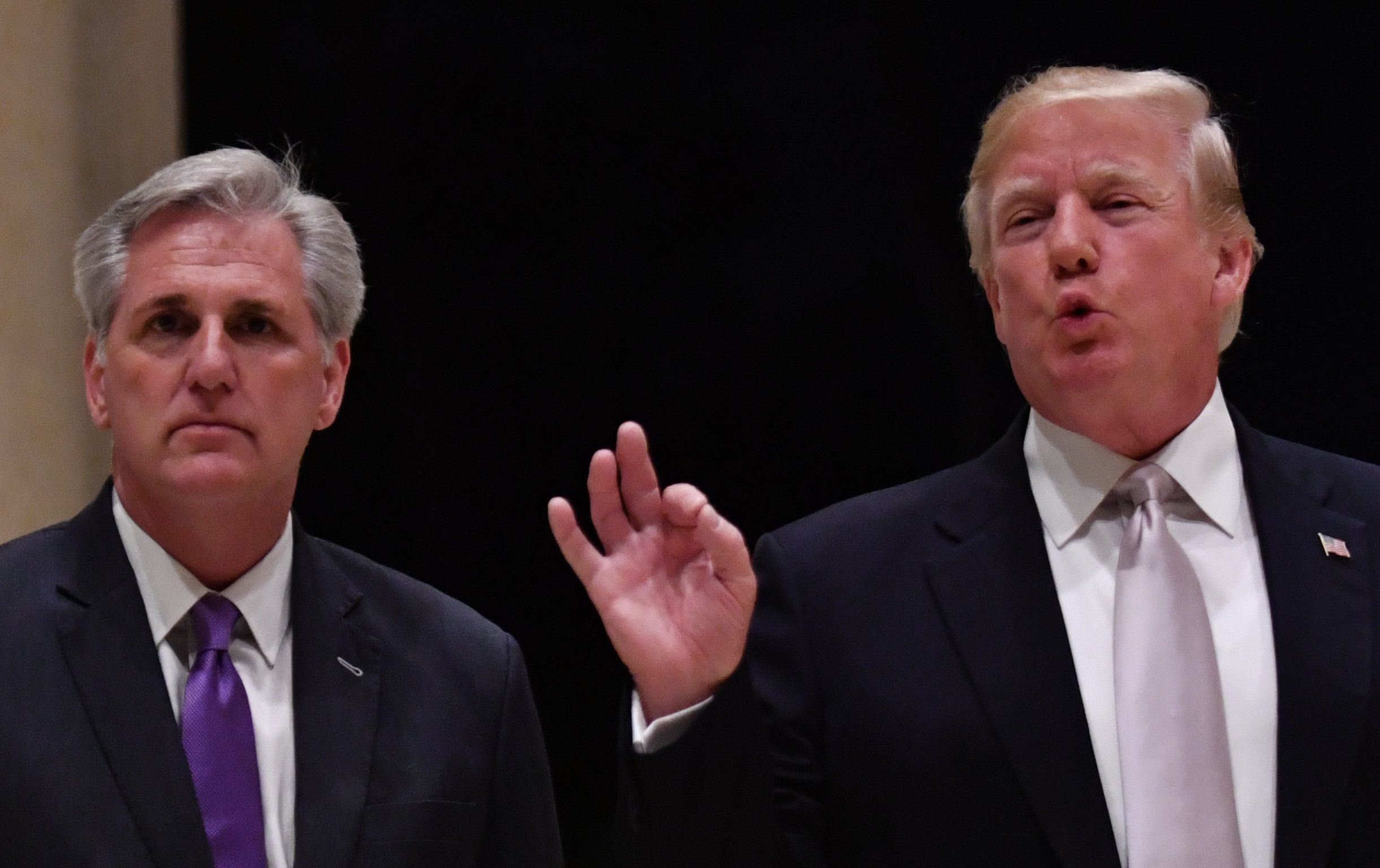 US President Donald Trump (R) speaks beside House Majority Leader Kevin McCarthy (L) at Trump International Golf Club in West Palm Beach on January 14, 2018.  / AFP PHOTO / Nicholas Kamm        (Photo credit should read NICHOLAS KAMM/AFP/Getty Images)