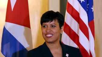Washington Mayor Muriel Bowser stands between Cuban (L) and U.S. national flags during a news conference in Havana, February 22, 2016. REUTERS/Alexandre Meneghini
