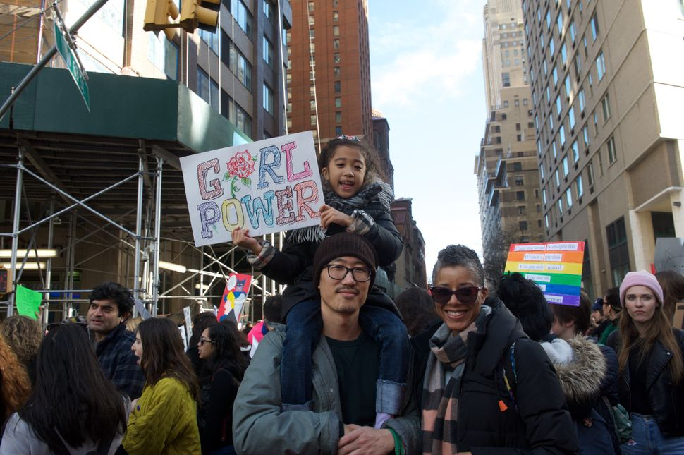 Marsha Annon, Yong Lee and their 7-year-old daughter at the NYC Women's March on Saturday.