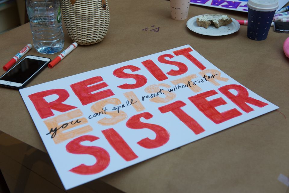 Marchers make signs at women's co-working space and social club, The Wing.
