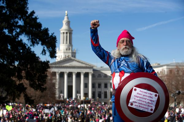 Ron Booth is dressed as 'A Captain America' during the Denver's Women's March at the Civics Center Park.