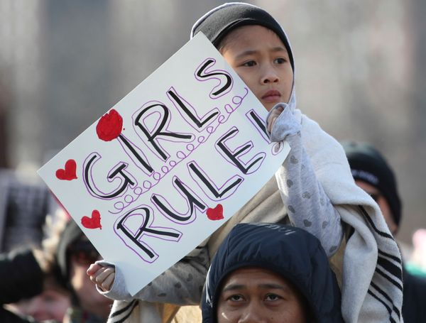 A girl holds a sign as she takes part in the Second Annual Women's March Chicago.