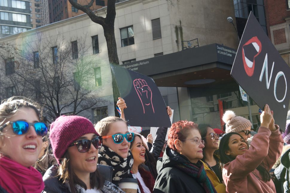 Marchers chant and hold up signs at the 2018 Women's March in New York City.