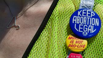GERMANTOWN, MD - JULY 31: Michelle Kinsey Bruns wears her support as she joins Pro Choice demonstrators who walk 1.3 miles around the abortion clinic where LeRoy Carhart performs late term abortions Sunday, July 31, 2011 in Germantown, MD. They call their walk The Summer Celebration of Choice Kick-Off Walk. (Photo by Katherine Frey/The Washington Post via Getty Images)