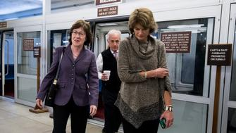 UNITED STATES - JANUARY 21: From left, Sen. Susan Collins, R-Maine, Sen. Bob Corker, R-Tenn., and Sen. Lisa Murkowski, R-Alaska, make their way to Senate Leader McConnell's office after meeting with other Senate moderates as they try to find a way to end the government shutdown on Sunday, Jan. 21, 2018. (Photo By Bill Clark/CQ Roll Call)