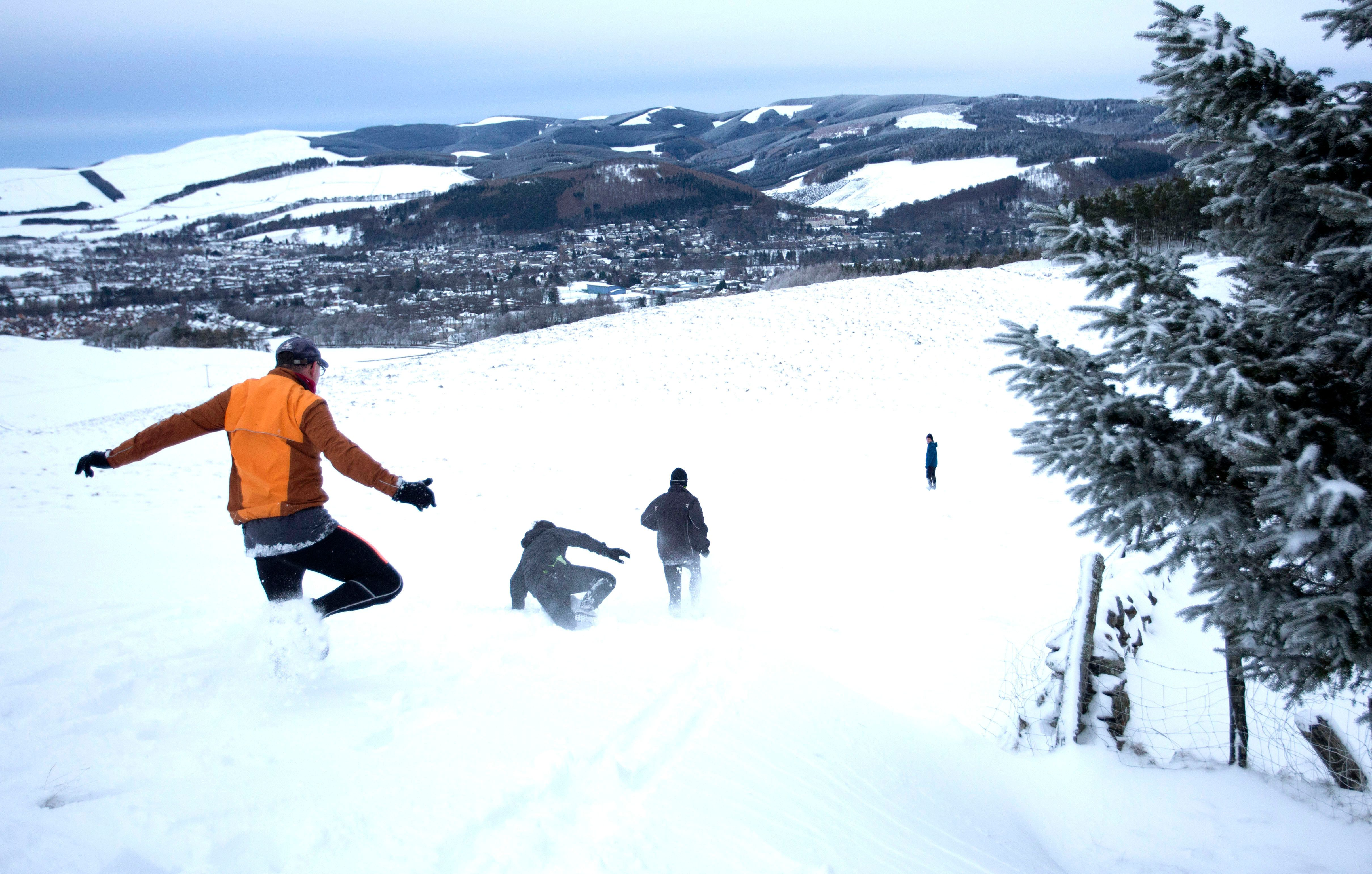 Cross-country runners set off through heavy snow around Peebles in the Scottish