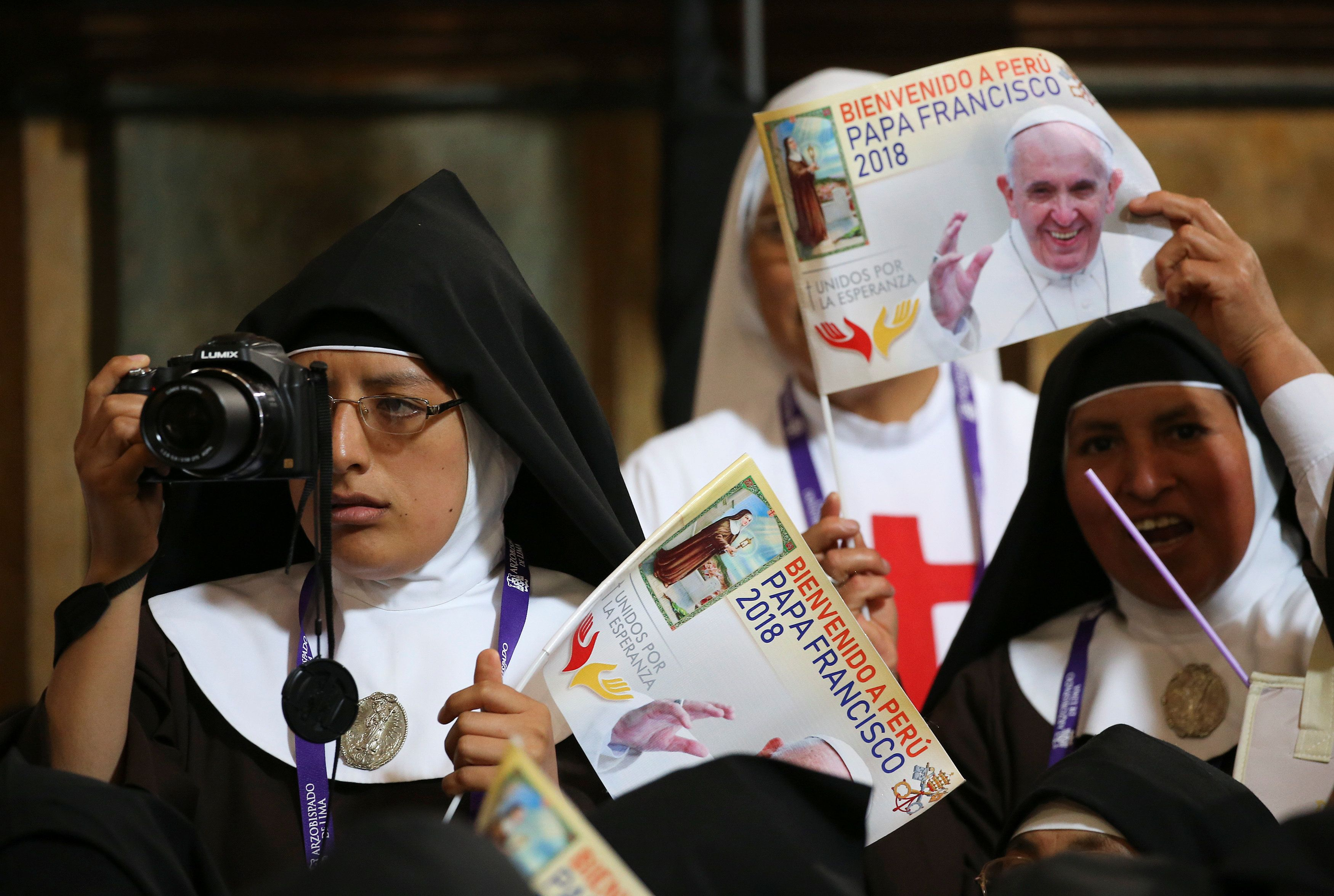 Nun snaps a photo of Pope Francis in Lima
