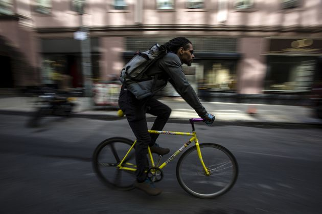 A bike messenger rides through New
