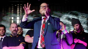 """Vice magazine co-founder Gavin McInnes speaks on stage with members of the Proud Boys organization at the """"A Night for Freedom"""" event organized by Mike Cernovich, in Manhattan, New York, U.S., January 20, 2018. REUTERS/Andrew Kelly"""