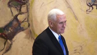 US Vice President Mike Pence is seen after signing the guest book at Israel's parliament in Jerusalem on January 22, 2018. The visit, initially scheduled for December before being postponed, is the final leg of a trip that has included talks in Egypt and Jordan as well as a stop at a US military facility near the Syrian border. Controversy back home over a budget dispute that has led to a US government shutdown has trailed Pence, and he sought to blame Democrats for the impasse during a speech to troops at the military facility a day earlier. / AFP PHOTO / POOL / Ariel Schalit        (Photo credit should read ARIEL SCHALIT/AFP/Getty Images)