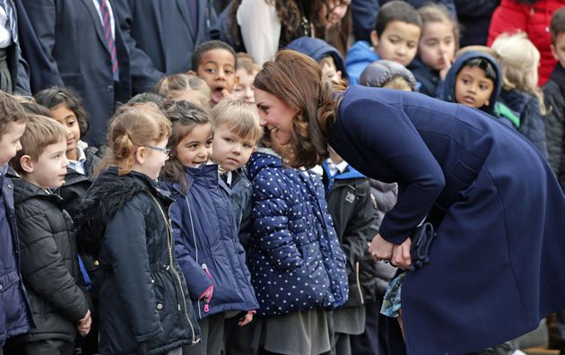 The Duchess of Cambridge greets children at Reach Academy Feltham in London, a school working in partnership...