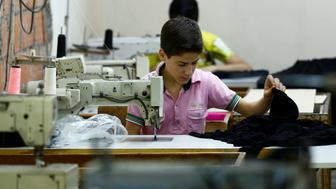 Muhamed, a Syrian refugee boy, works at a small textile factory in Istanbul, Turkey, June 24, 2016. Picture taken June 24, 2016.   To match Special Report EUROPE-MIGRANTS/TURKEY-CHILDREN    REUTERS/Murad Sezer