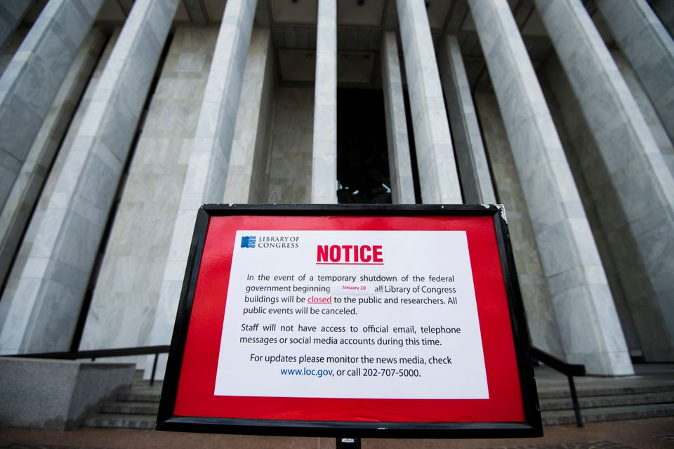 Signs posted outside the Library of Congress in Washington on Sunday, Jan. 21, 2018, notify visitors that all Library of Cong