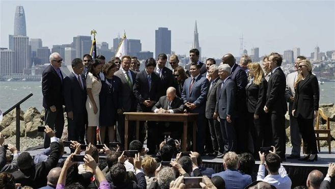 California Gov. Jerry Brown, a Democrat, signs legislation in 2017 renewing California's cap-and-trade system. Brown is one o