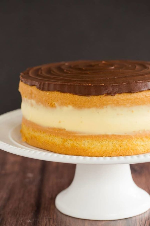 "<strong>Get the <a href=""https://www.browneyedbaker.com/boston-cream-pie-ii/"" target=""_blank"">Boston Cream Pie</a> recipe fro"